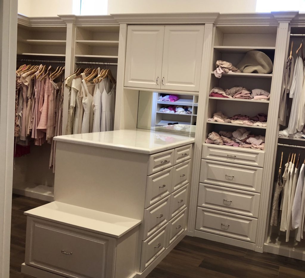 Custom Closet with a white mirror in the background