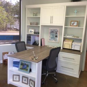 A picture of a custom built office with a cabinet and shelves