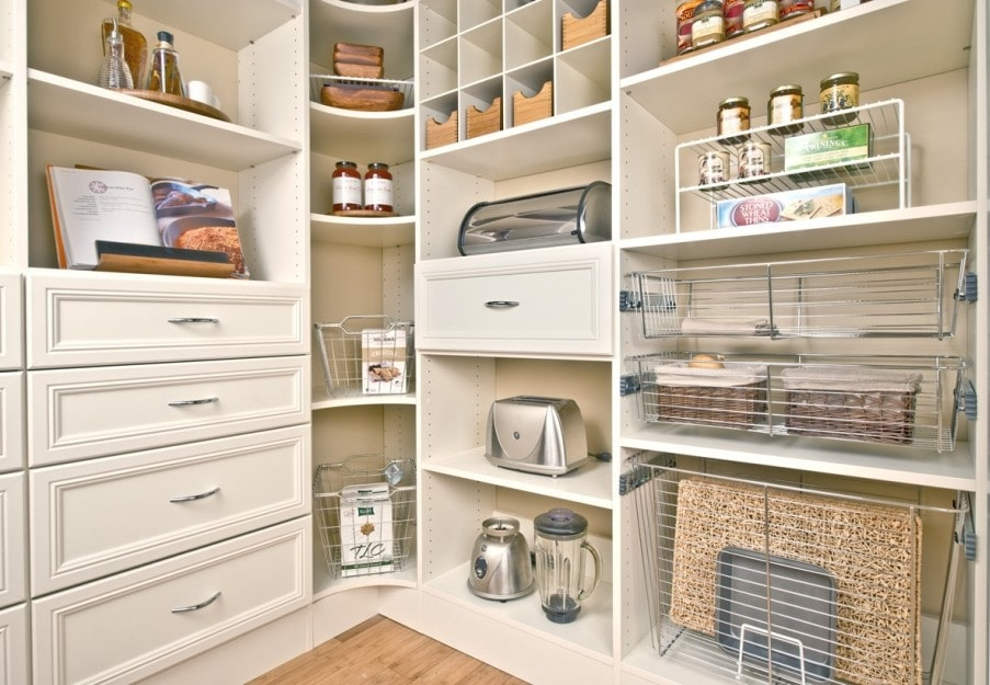 Custom pantry with kitchen supplies on the shelves