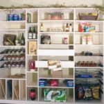 Custom pantry fully stocked with goods