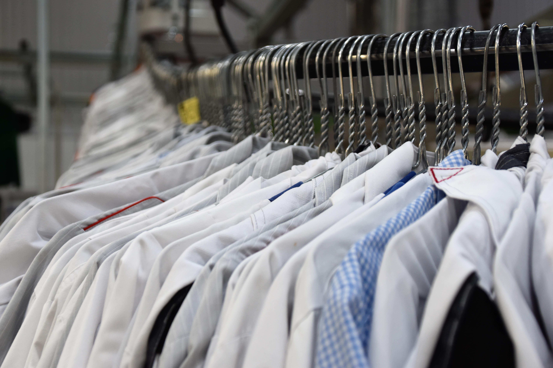 A shirt rack with dress shirts