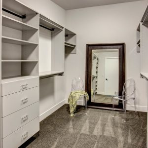 Custom Closet with a mirror wall mounted