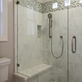 A frameless shower with tiles