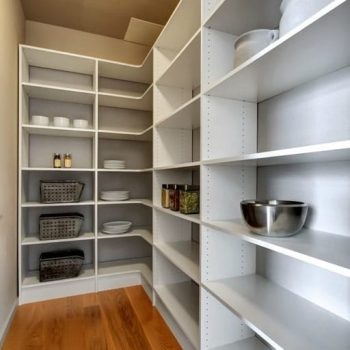 Custom pantry with hardwood flooring